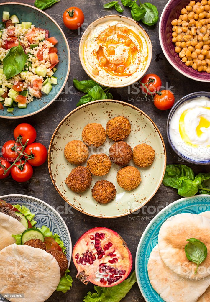Table served with middle eastern traditional dishes stock photo
