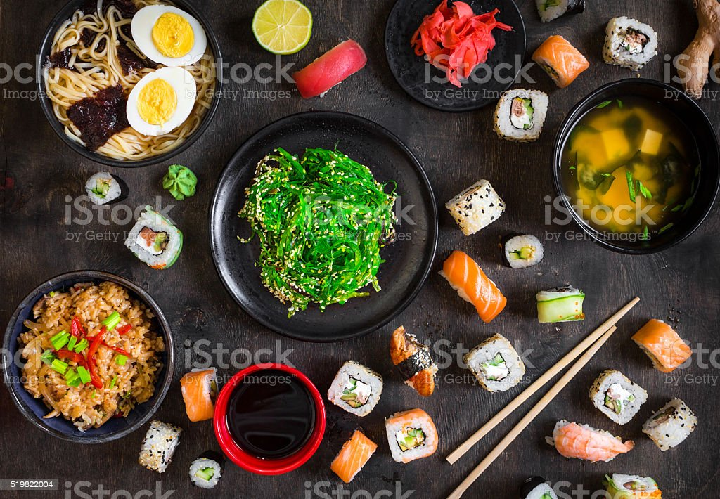 Table served with sushi and traditional japanese food stock photo