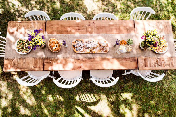 Table set for a garden party or celebration outside. stock photo