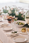 Table set for an event party or wedding reception. Banquet table design