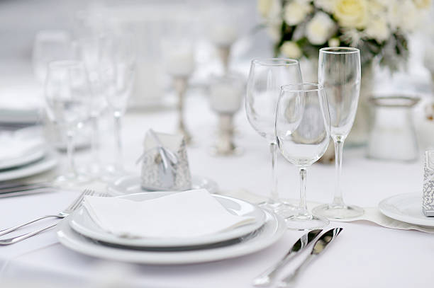 table set for an event party or wedding reception - glas serviesgoed stockfoto's en -beelden