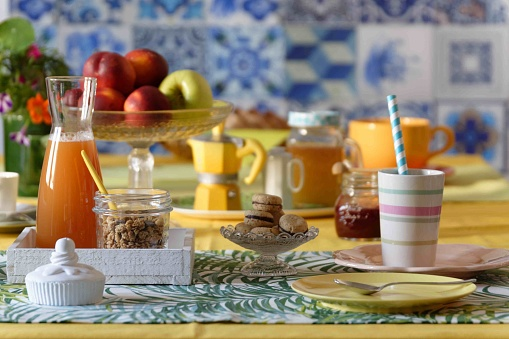 Table set for morning breakfast with food and props in sunny atmosphere