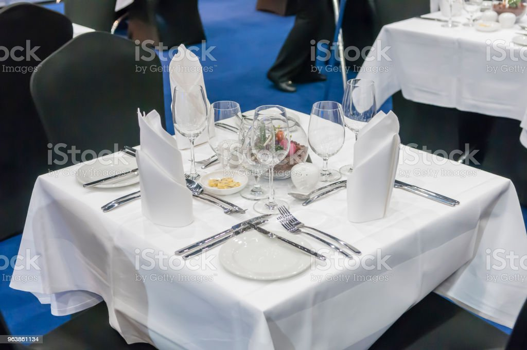 Table set for three people at a conference. - Royalty-free Arrangement Stock Photo