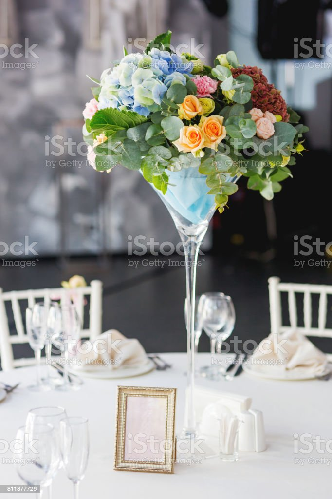 Table Set For Wedding Banquet With Floral Composition Of Roses And Hydrangea Flower Decoration In Tall Vase Stock Photo Download Image Now Istock
