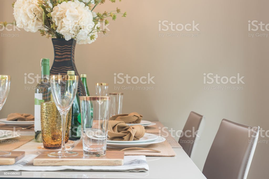 table set on dining table in modern dining room stock photo