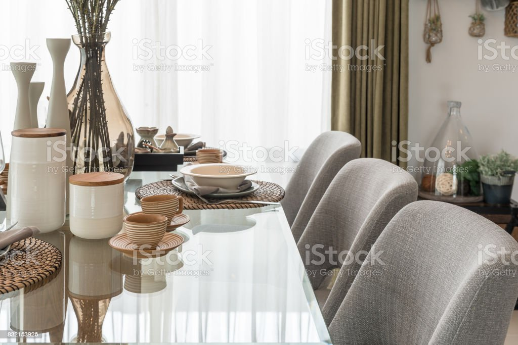 Table Set On Glass Dining Table In Modern Dining Room Stock Photo Download Image Now Istock