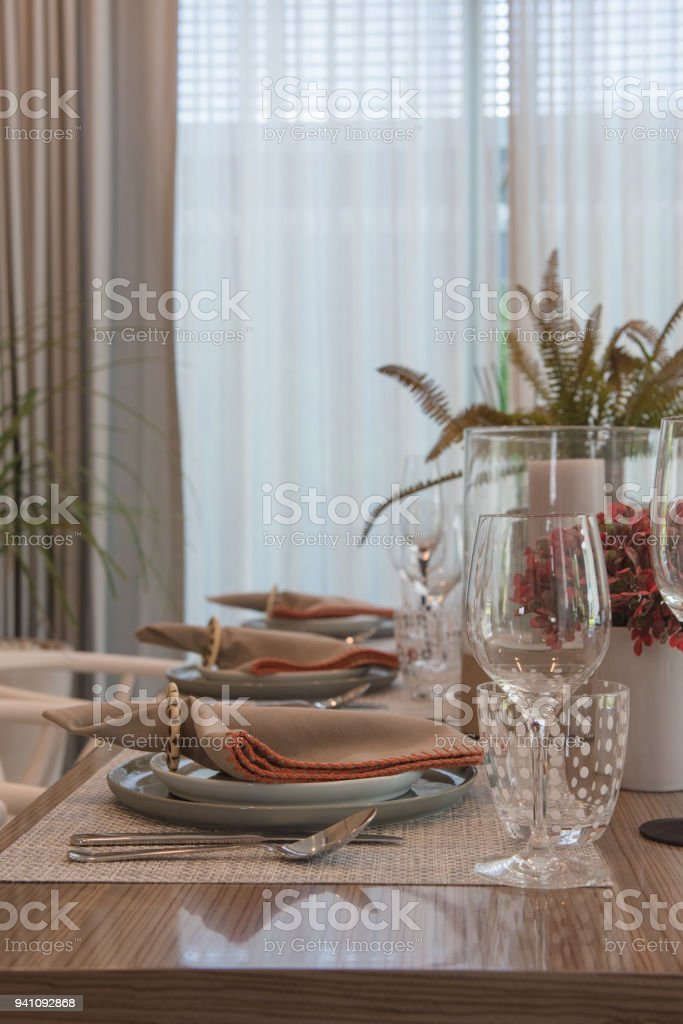 table set on wooden dining room stock photo