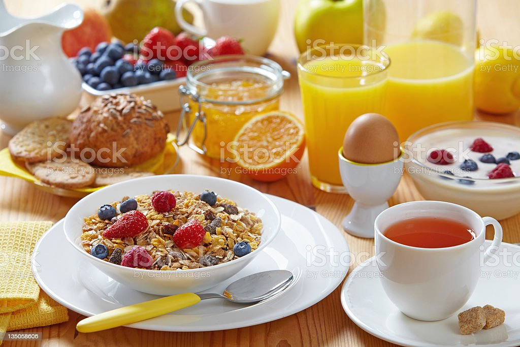 A table set with healthy breakfast foods and drink royalty-free stock photo