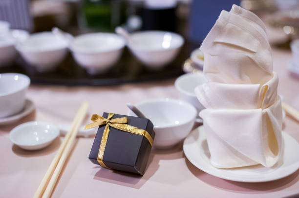 Table setting and gift in wedding banquet Image of Table setting in wedding banquet. chinese wedding dinner stock pictures, royalty-free photos & images
