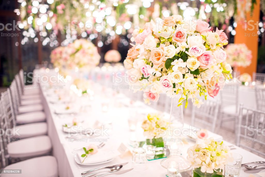 Table setting at a luxury wedding and Beautiful flowers on the table. stock photo