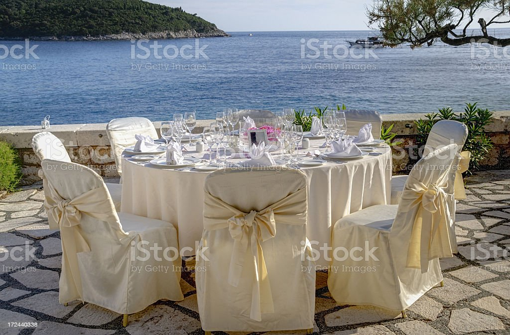 Table setting for an outdoor reception next to the sea royalty-free stock photo
