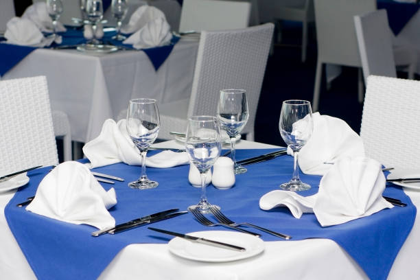 table setting for four people in a restaurant - blue table setting stock photos and pictures