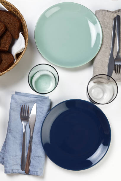 table setting for two - blue table setting stock photos and pictures