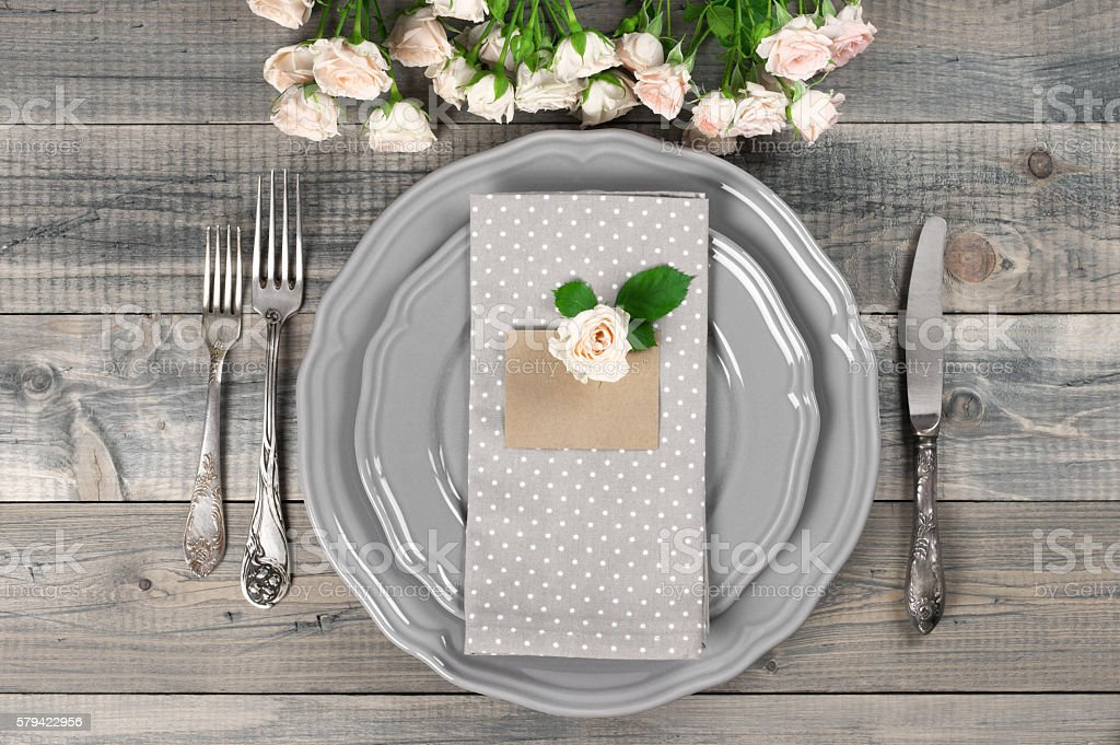 Table setting in gray stock photo
