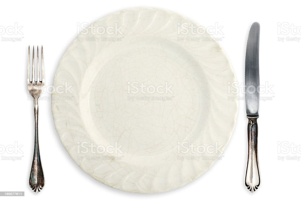 Table Setting; Old Empty Plate and Silverware stock photo