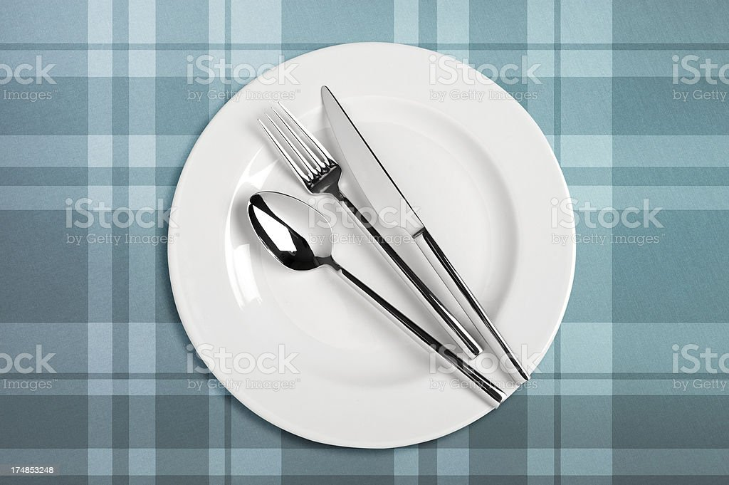 Table setting on plaid tablecloth royalty-free stock photo