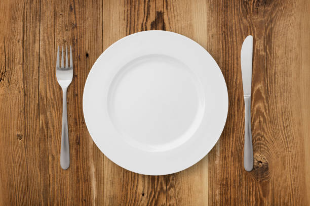 table setting on wood - plate stock pictures, royalty-free photos & images