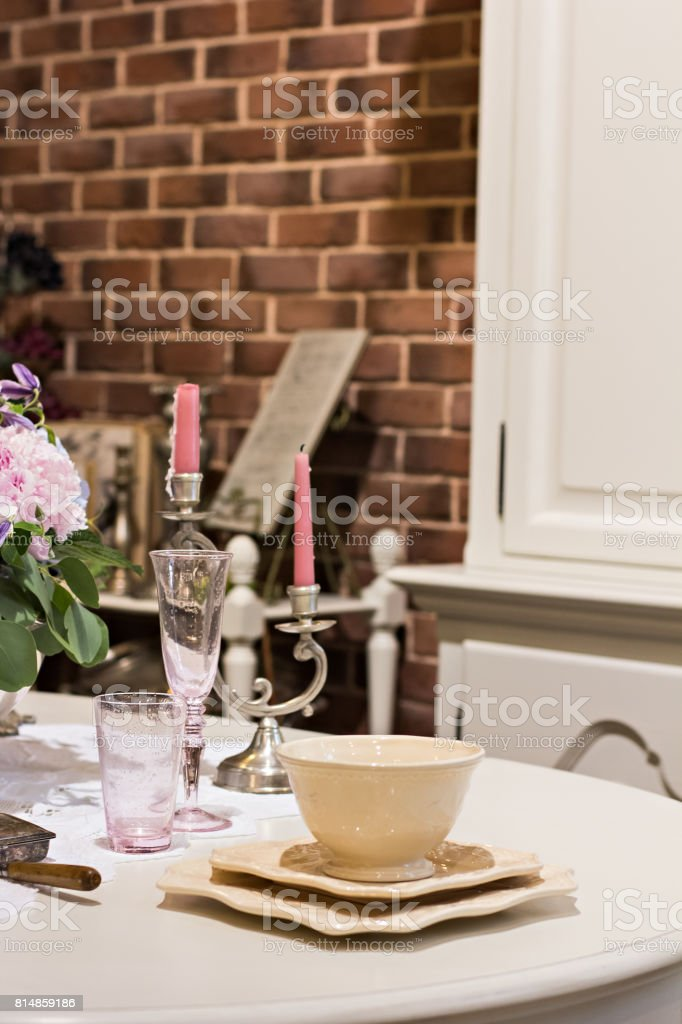 Table setting. Plates on the table, a festively laid table. stock photo