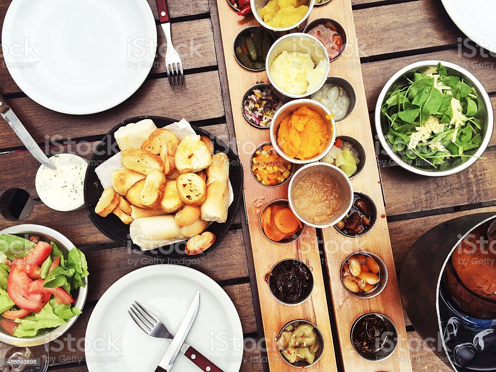 Table setting with a variety of side dishes stock photo