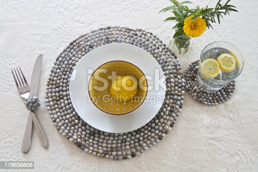 Table place setting with beaded place mats made by African craftsmen