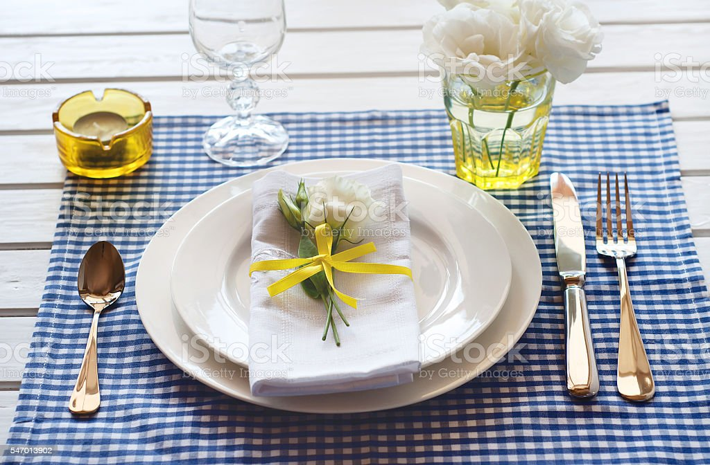 Table Setting With Blue Checkered Tablecloth White Napkin Yellow ...