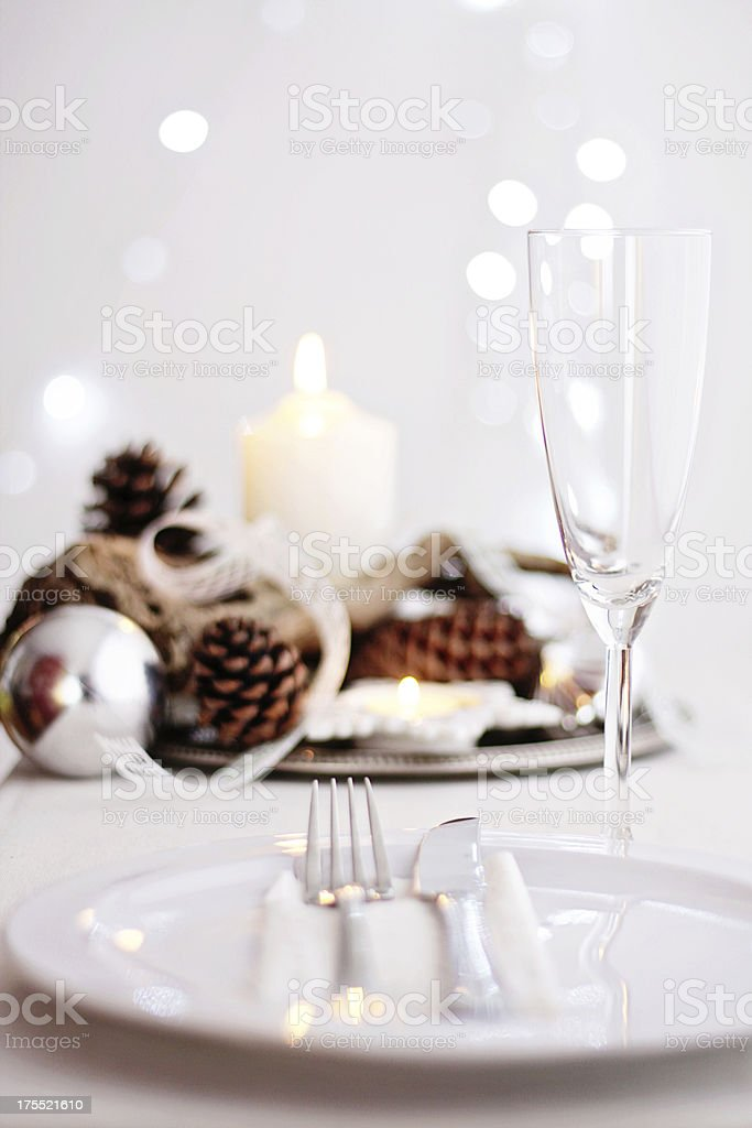 Table setting with champagne glass and Christmas centrepiece royalty-free stock photo