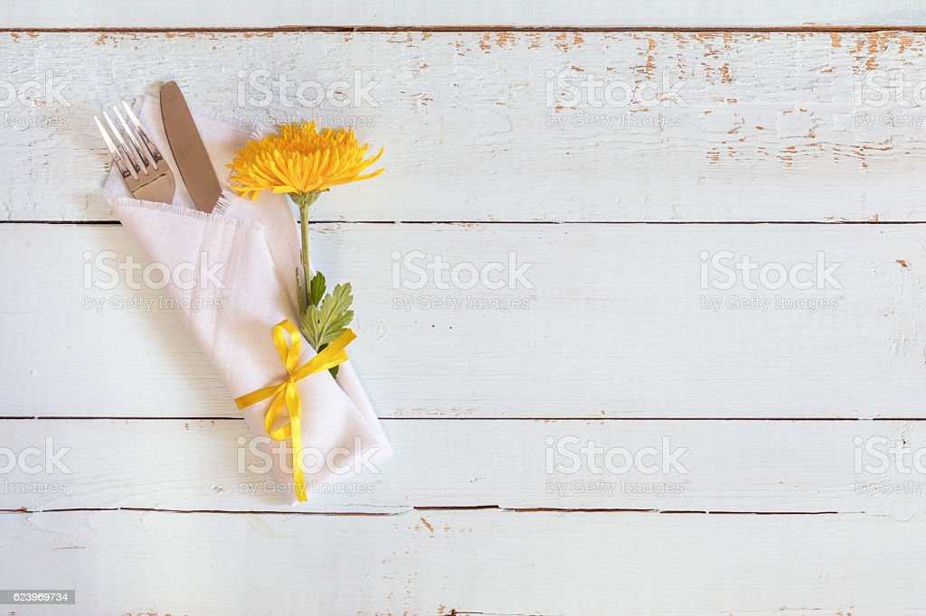 Table setting with chrysanthemum and cutlery. royalty-free stock photo