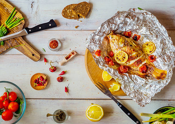Table setting  with different dishes and grilled fish stock photo