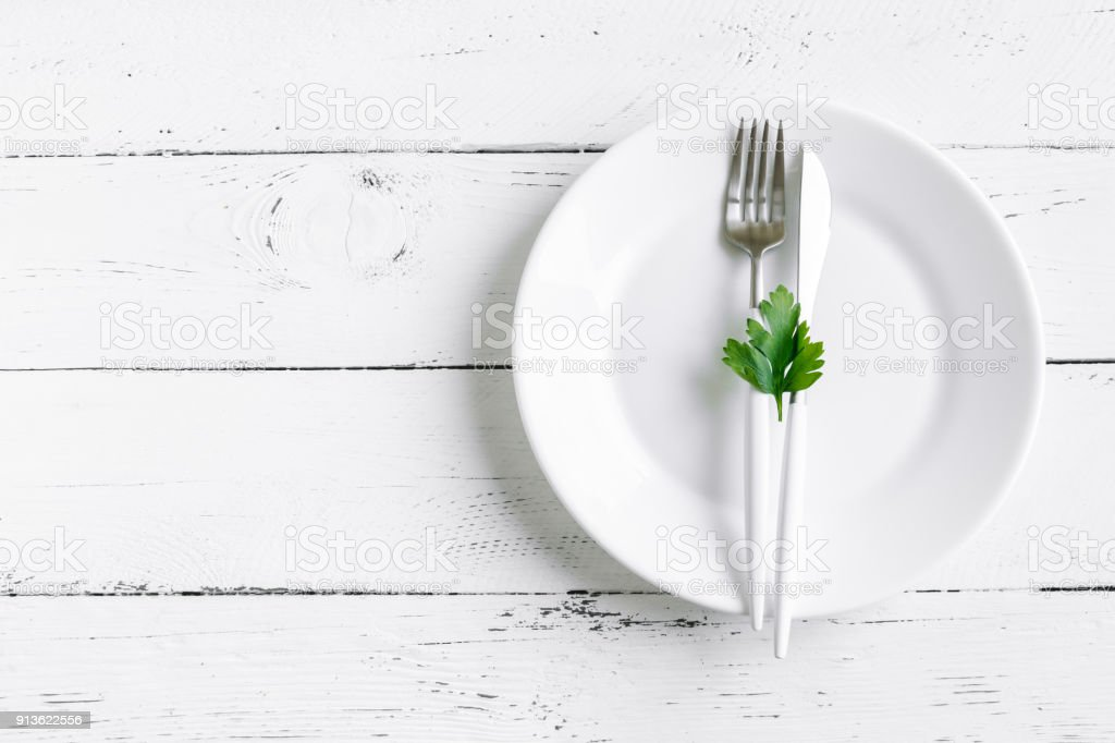 Table setting with parsley leaf stock photo