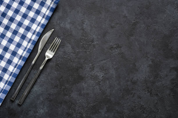 table setting with silverware and textile on black concrete - blue table setting stock photos and pictures