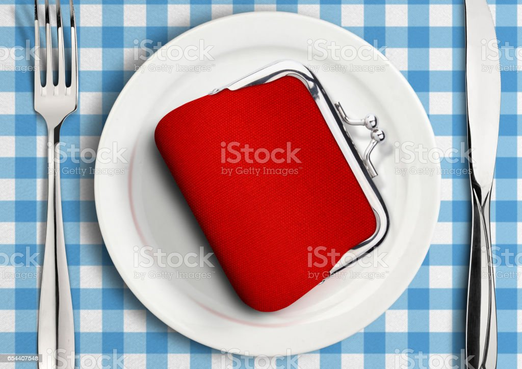 Table setting with wallet on plate, finance concept stock photo