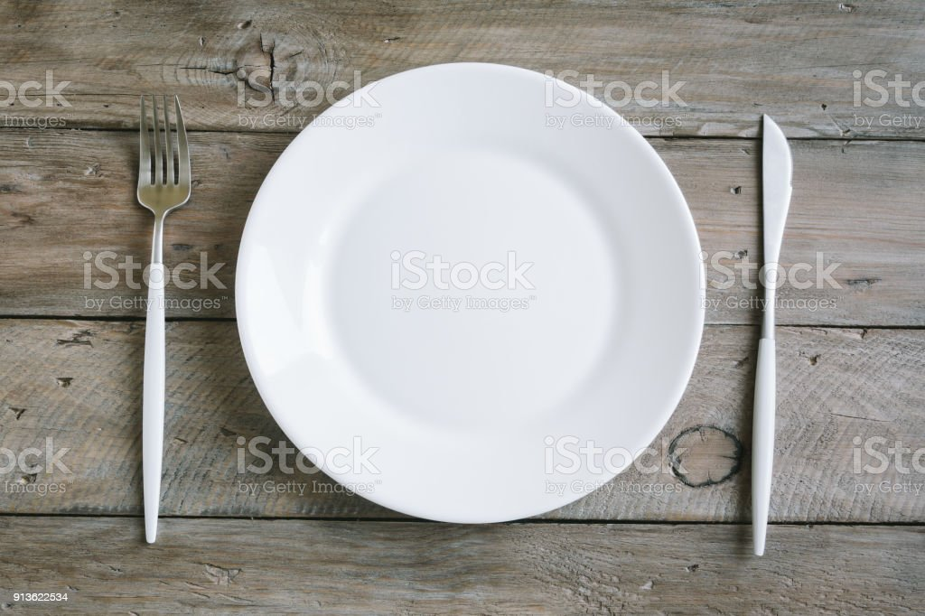 Table setting with white plate, modern cutlery stock photo