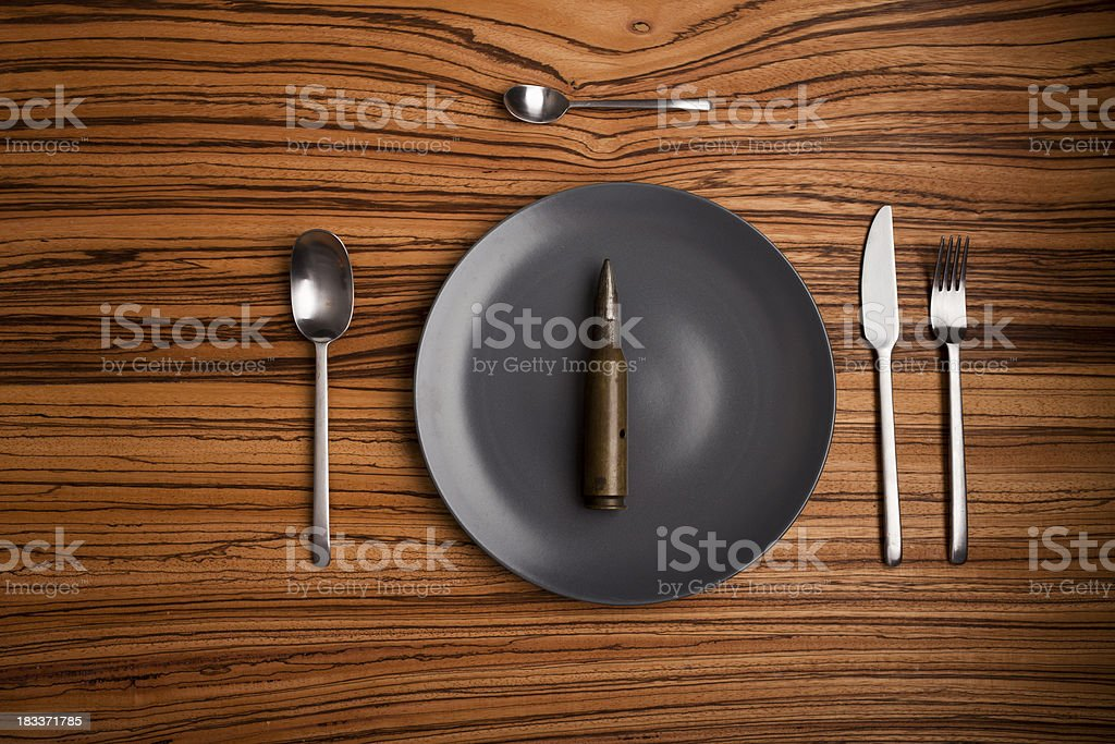 Table setup with a bulletinstead of food stock photo