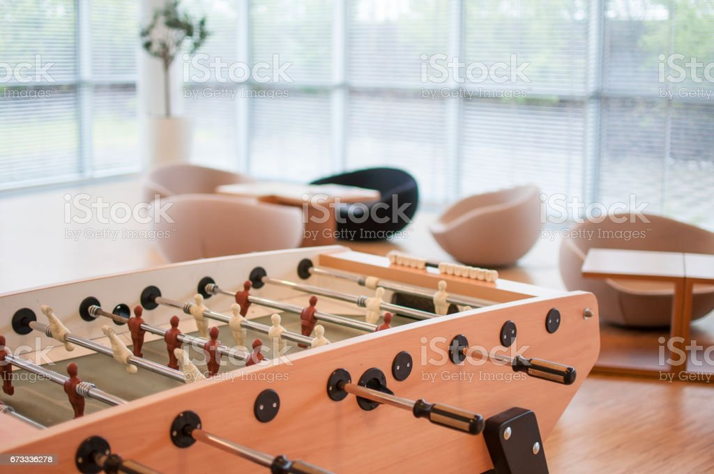 Table soccer in a large office room stock photo