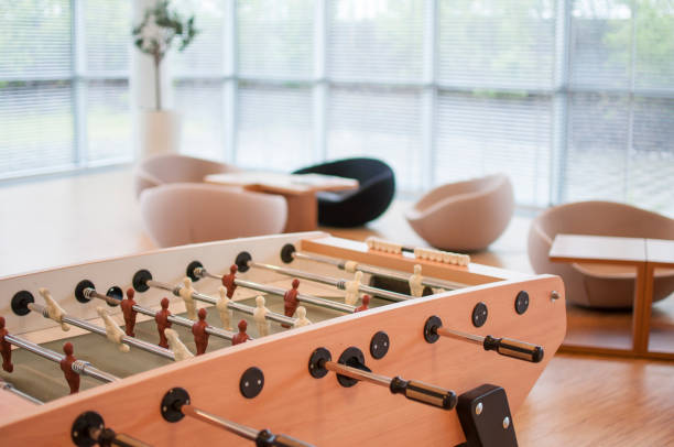 Table soccer in a large office room - foto de acervo