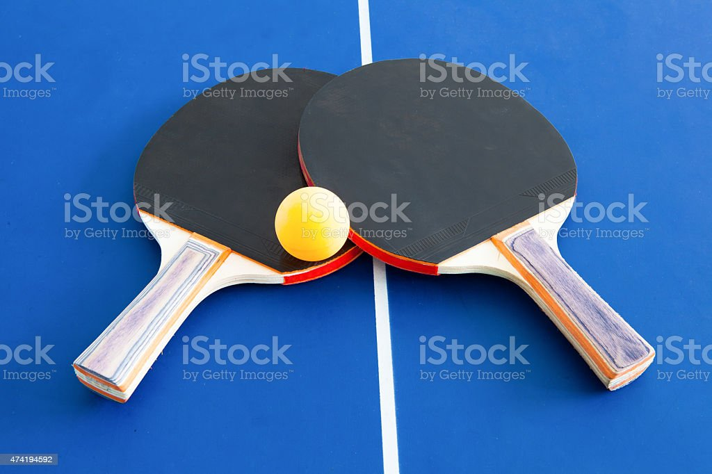 Table tennis and ball symbol laying on table stock photo