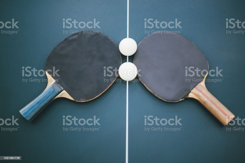 Pair of Table Tennis rackets and two Table Tennis balls on a Table...