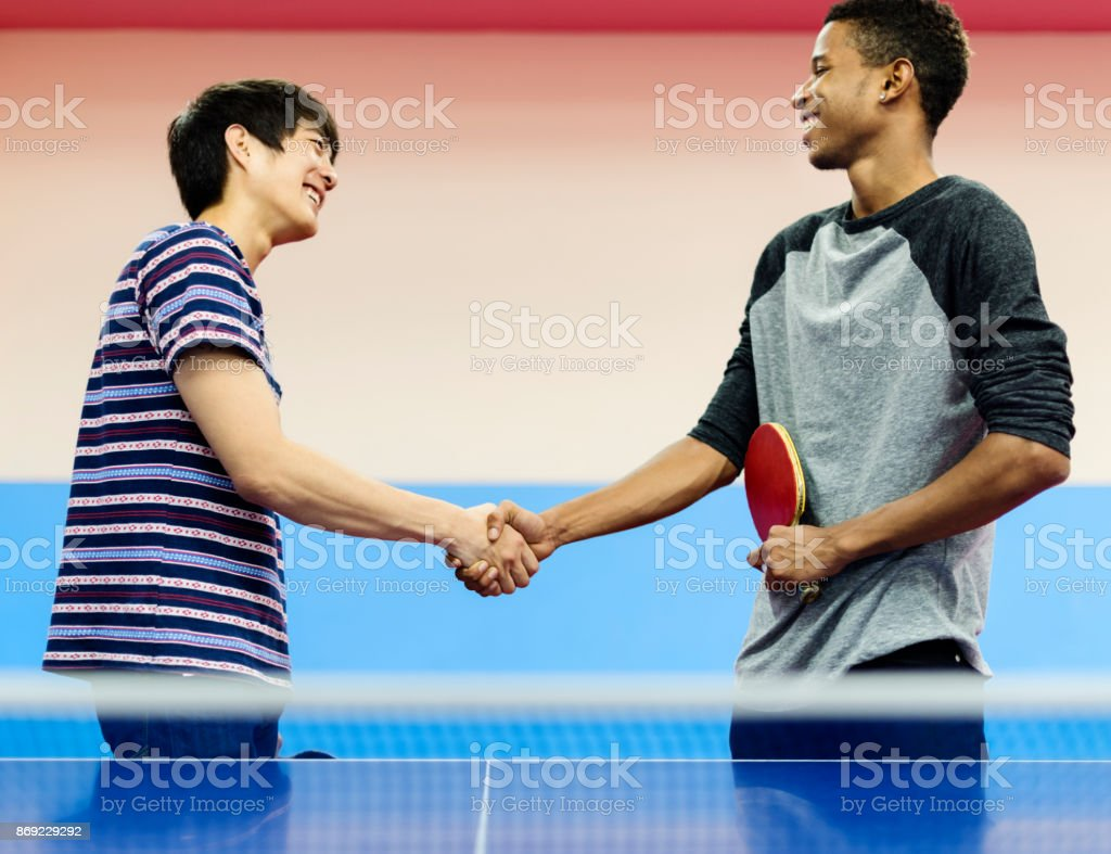 Table Tennis Players Shaking Hands Stock Photo - Download Image Now