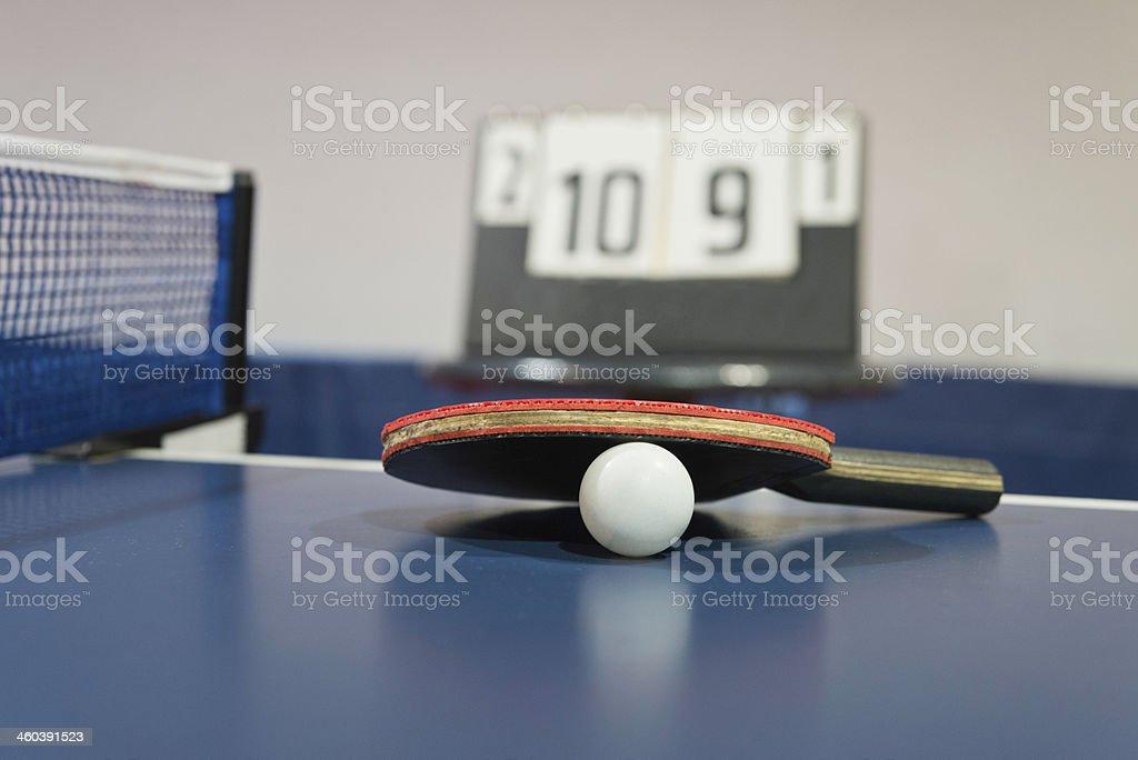 Table tennis racket and ping pong ball stock photo