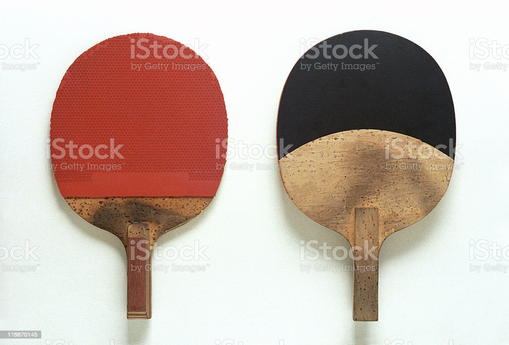 A table tennis racket has to be red on one side and black on the...