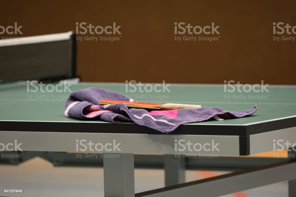 Table Tennis racket with towel on a Table Tennis Table - Focus at the...