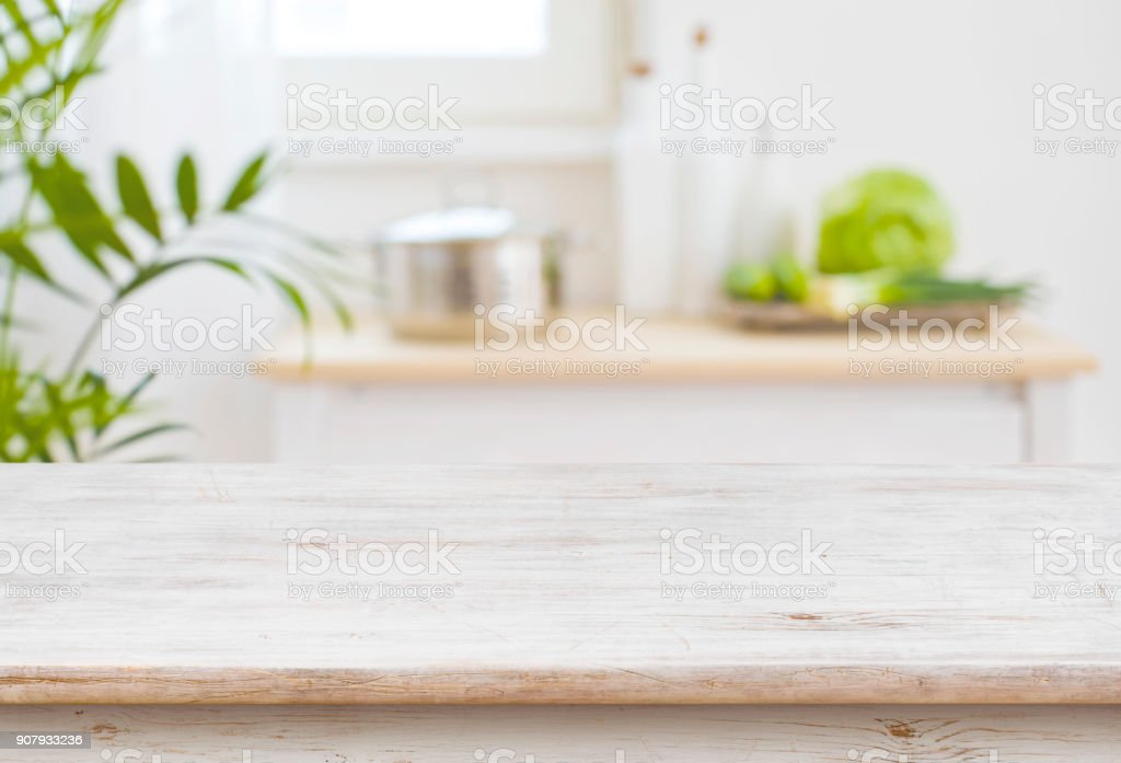 Table top and blurred kitchen room as background stock photo