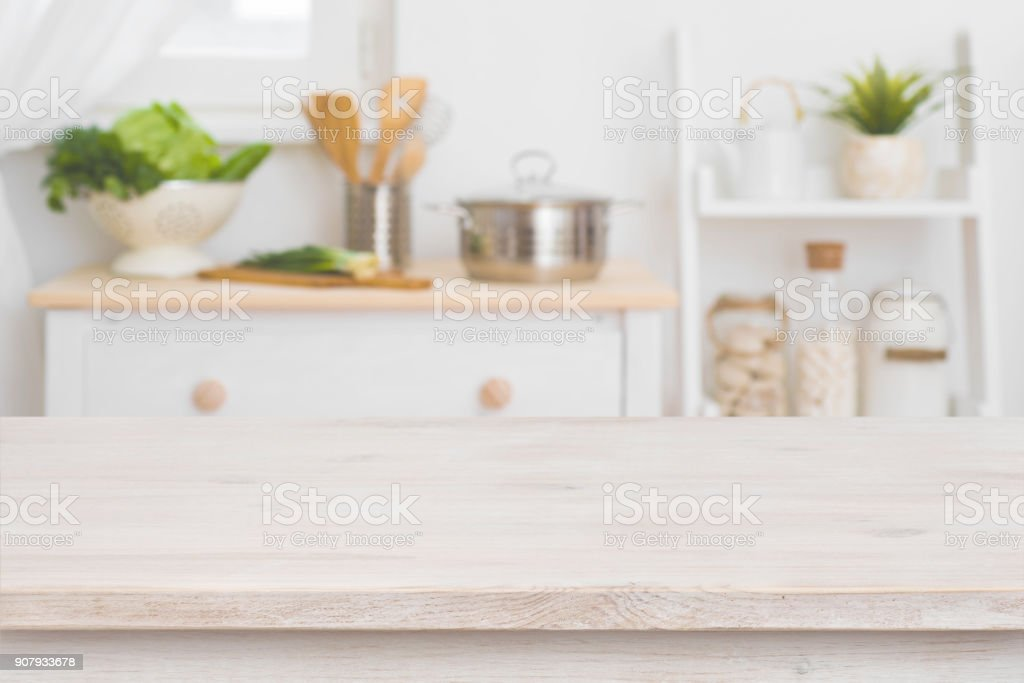 Table top and defocused kitchen interior as background stock photo
