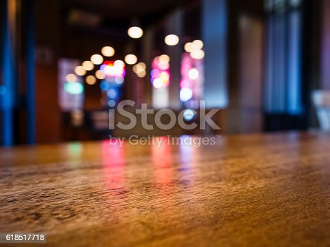 istock Table top Bar Blurred colourful lighting background Party event 618517718