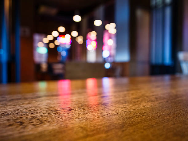 table top bar blurred colourful lighting background party event - fête de bureau photos et images de collection