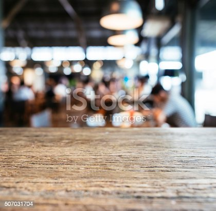 istock Table top counter Bar with Blurred people in Restaurant Cafe 507031704