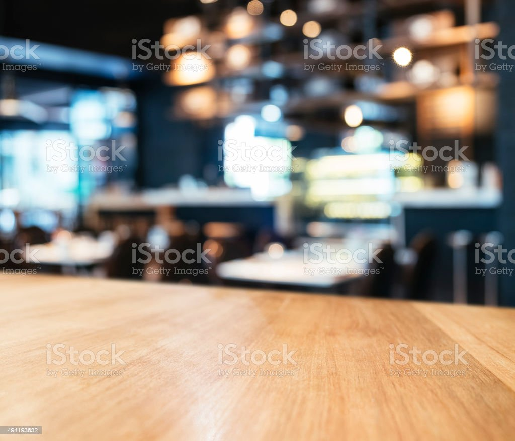 Table top Counter Bar with Blurred Restaurant Shop Background stock photo