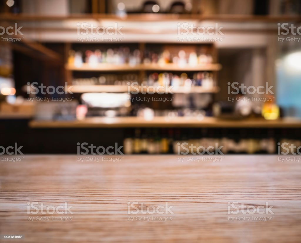 Table top wooden counter Blur Bar shelf people drinking Cafe...