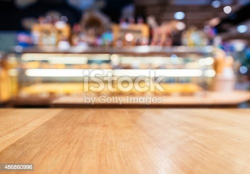 istock Table Top Counter with Blurred Bakery display shelf 486860996