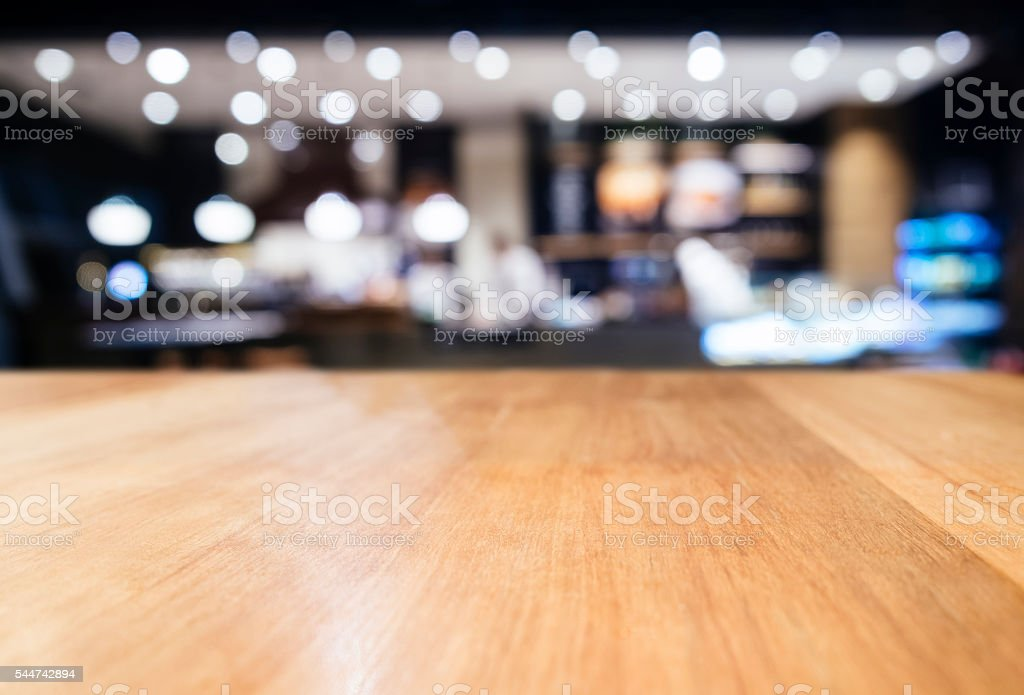 Table top counter with Blurred Bar Restaurant Lighting decoratio stock photo
